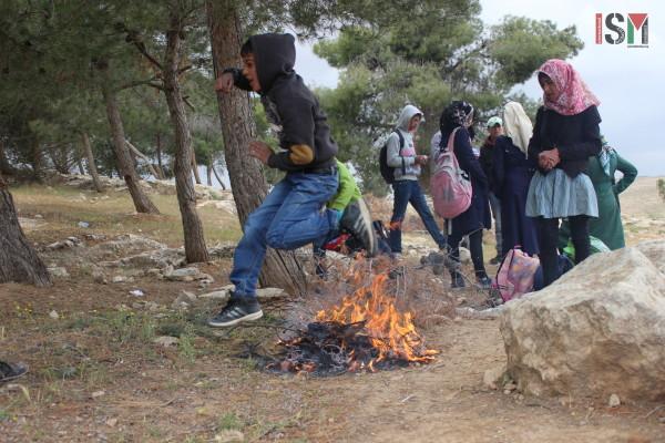 School children amusing themselves before taking the dangerous walk home.