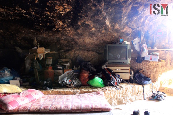 TV inside the cave. Electricity is powered by their wind turbine.