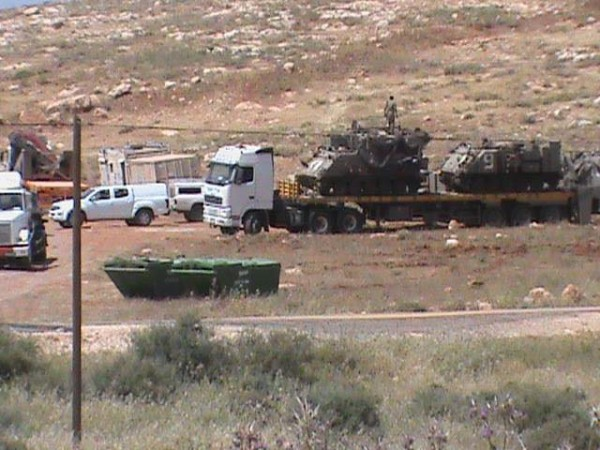 Israeli occupation forces present on Palestinian land near Aqraba (Photo by Aqraba Muncipality 24.04.15)
