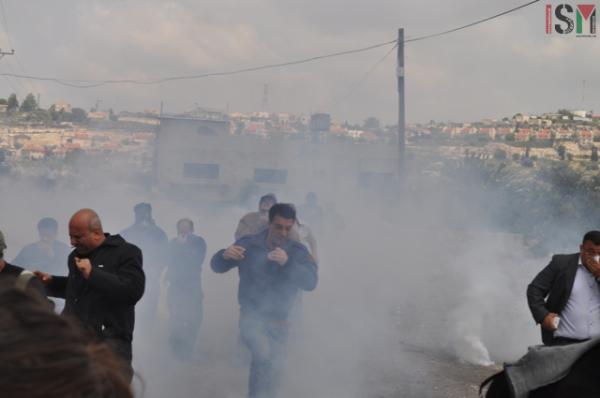 Protestors being tear gassed