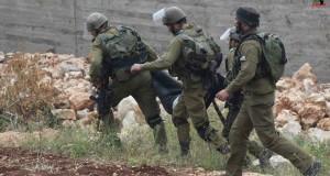 Israeli forces arresting an unconscious man