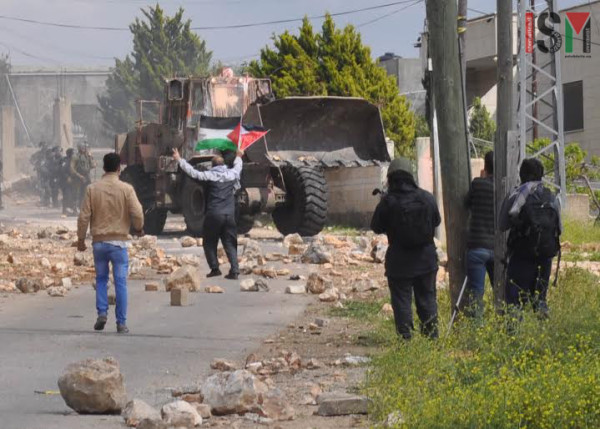 Israeli military bulldozer- splattered with paint thrown by protesters
