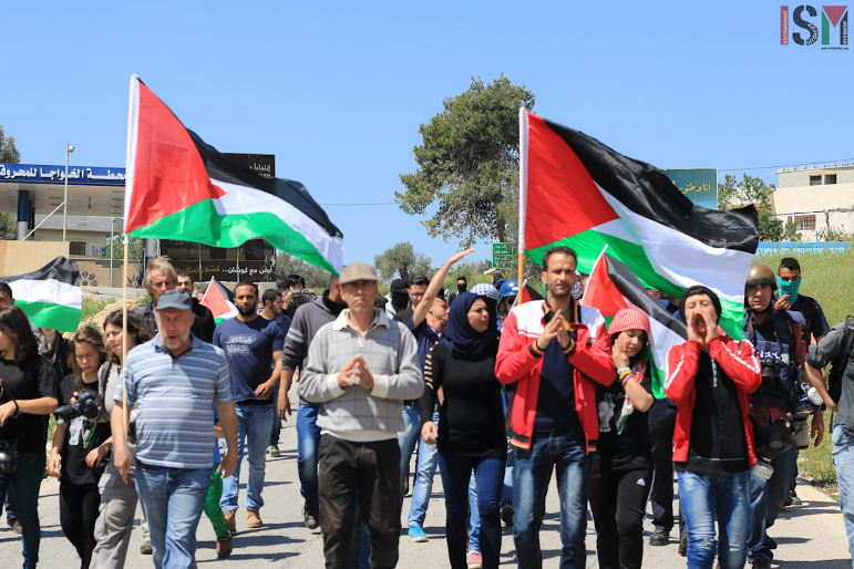 Protesters march in Nabi Saleh (photo by ISM)