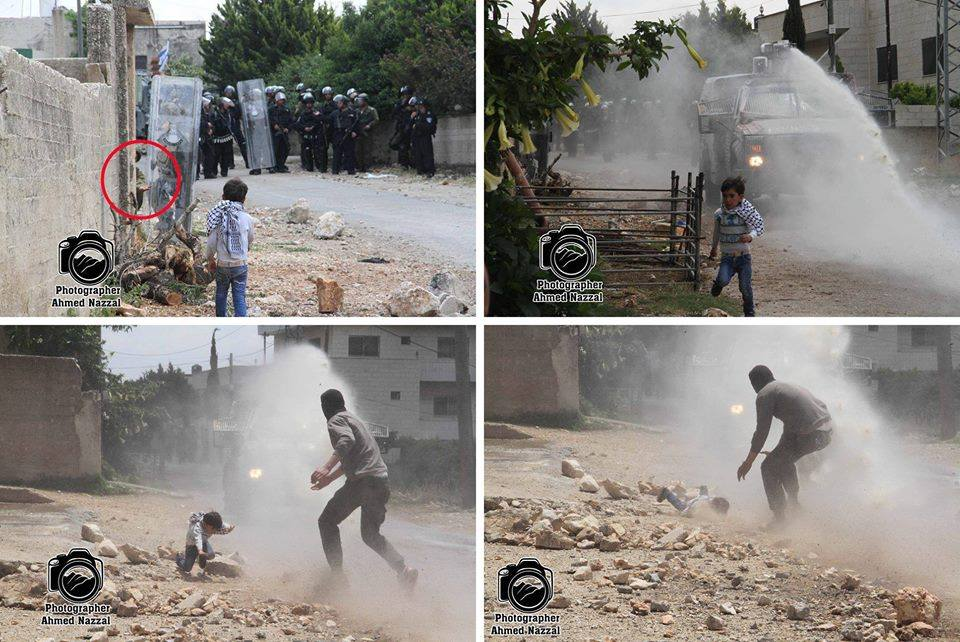 """Israeli forces trip young boy over with skunk 'water"""" - photo by Ahmed Nazzal"""