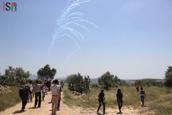Tear gas fired at the demonstration by the Israeli forces
