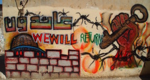 """We will return"". The camp's walls are covered in graffiti of resistance"