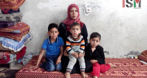 Mohamed's wife with their three children.