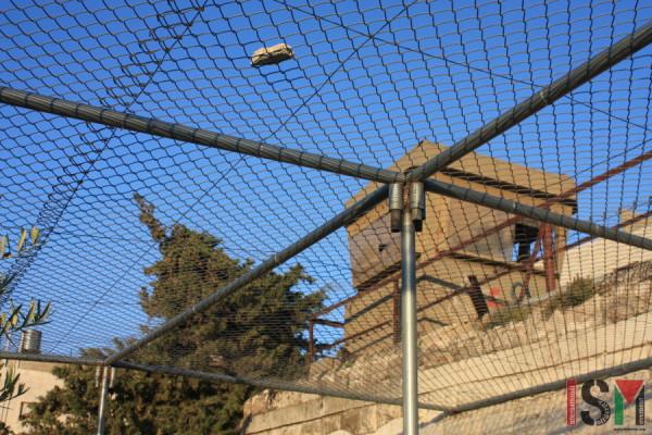 The fence over the Abu Shamsiye family's terrace