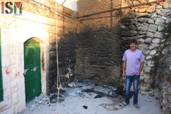Imad Abu Shamsiyeh outside his home