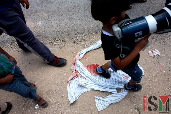 A blood stained shirt on the ground in the streets of Kafr Qaddum