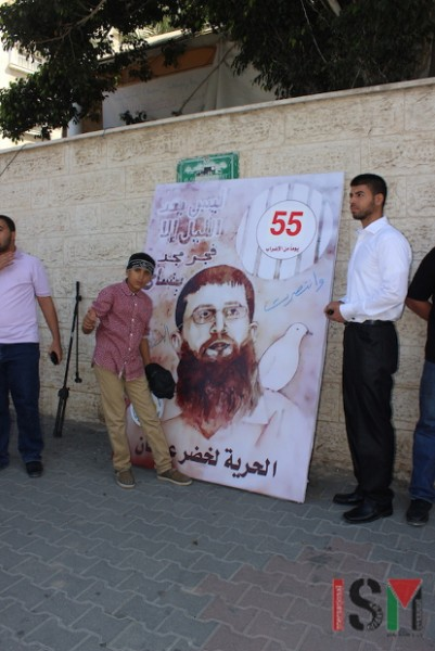 A mural of Khader Adnan with the number 55, the number of days he was on hunger strike this time.