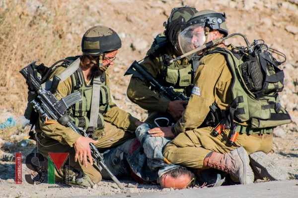Soldiers crushing a Palestinians head