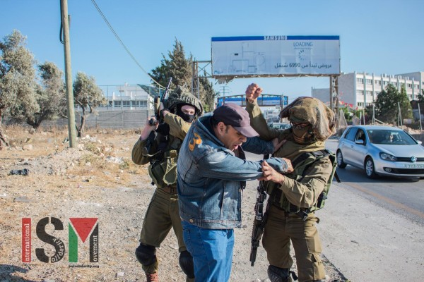 Soldiers beating a Palestinian man