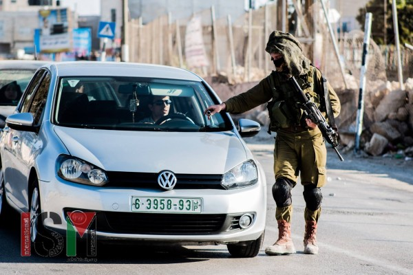 Soldier taking the keys of a Palestinian's car