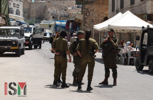 Israeli forces guarding the settler tent.