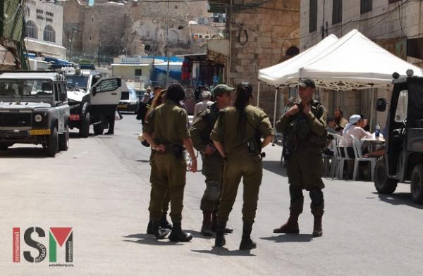 Israeli forces guarding the settler tent.