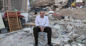 Nureddin Amro sitting on the rubble of his home, which was demolished on March 31st this year (photo credit The Washington Post)