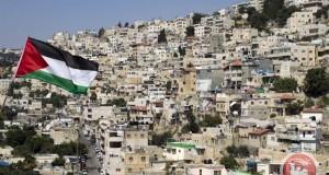 Picture showing a Palestinian flag fluttering in front of buildings in the east Jerusalem neighborhood of Silwan. (AFP/File Ahmad Gharabli)