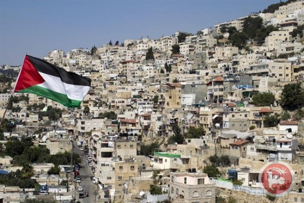 Picture showing a Palestinian flag fluttering in front of buildings in the east Jerusalem neighborhood of Silwan. (AFP/File Ahmad Gharabli)