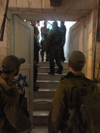 Israeli soldiers coercing Palestinians off the street Photo credit: Youth against Settlement