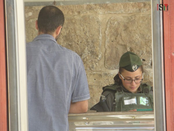 Israeli soldier trying to find the right ID to give back after prayer