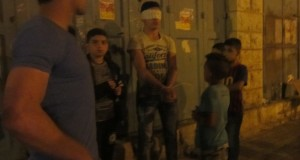 Boy blindfolded and handcuffed by Israeli army