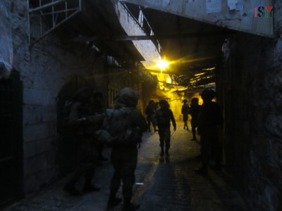 Israeli forces during a night patrol in the Palestinian market