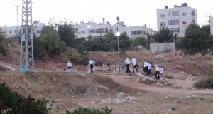 Settlers coming from the illegal settlement of Kiryat Arba onto Palestinian land for prayers