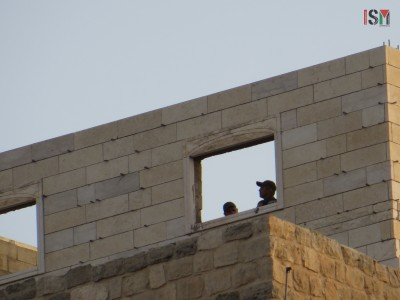 Israeli forces taking over a Palestinian house as a look-out