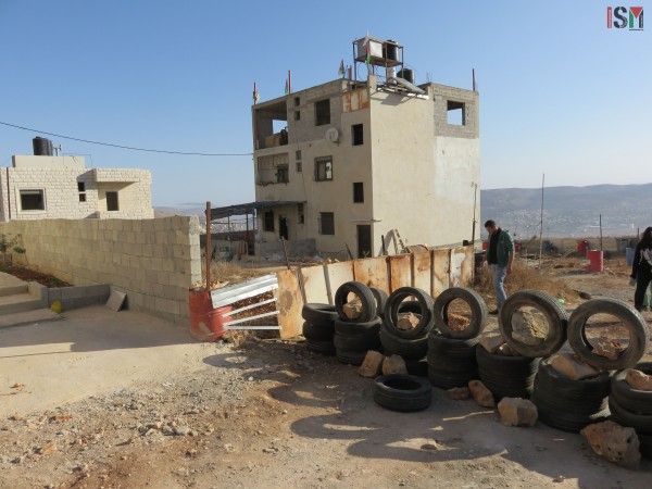 The Al-Kusa family home on the first floor of the building is now abandoned, waiting to be filled up with concrete by the Israeli army.