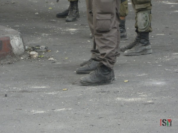 Live ammunition bullet casings litter the ground at the site of today's demonstration in Bab al-Zawiyah in al-Khalil (Hebron)