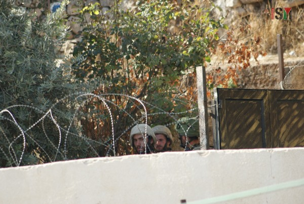 Israeli forces blocking the entrances to a Palestinian house