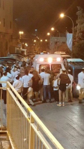Photo Credit: Youth Against Settlements. Ambulance carrying dying Palestinian prevented from leaving Shuhada Street by frenzied settlers.