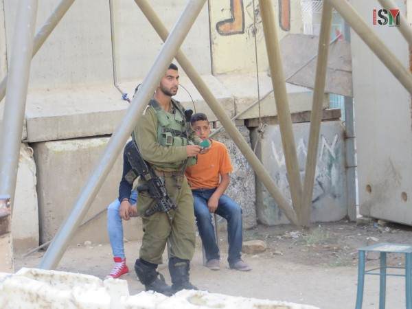 Mohammed (right) and another Palestinian boy detained at Shuhada checkpoint
