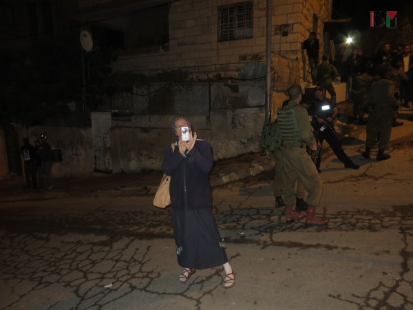 Settler woman photographing internationals getting attacked