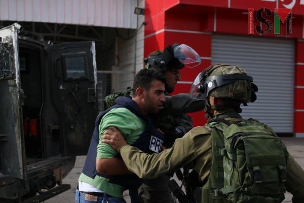 Journalists harassed by Israeli Forces (Photo credit: Mohannad Darabee, ISM)