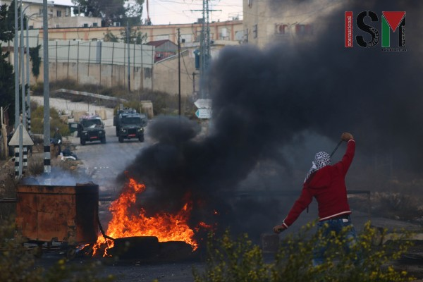 "Demonstrator at Beit El, ""the war on stone-throwers"" (Photo credit: Mohannad Darabee, ISM)"