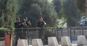 Israeli forces threatening Palestinian bystanders