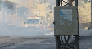 Palestinian ambulance forced to go through clouds of tear gas