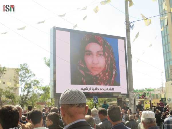 Electronic billboard with pictures of the killed teens.