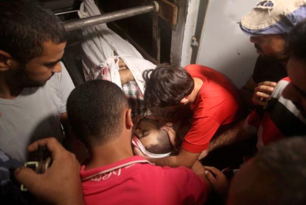 The body of Ahmed Al Sarhi, killed by snipers of the Zionist occupation forces on October 20, 2015, Al Bureij, Gaza Strip (Photo credit: Ashraf Amra)