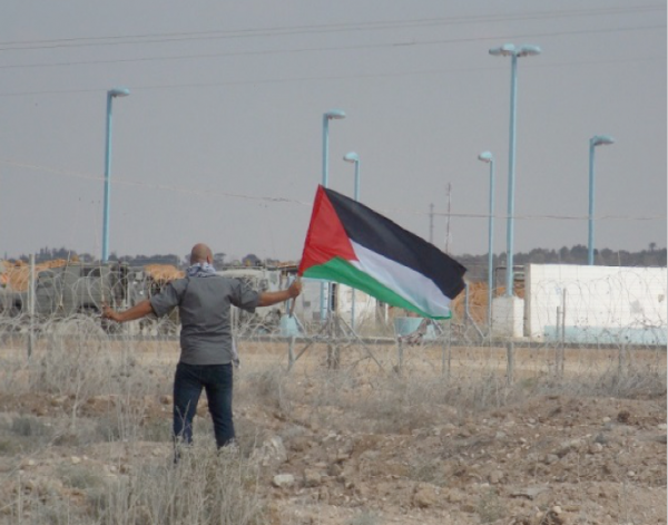 Young man a few meters from the zionist fence. Picture in Gaza Strip, Palestine. September 2013.