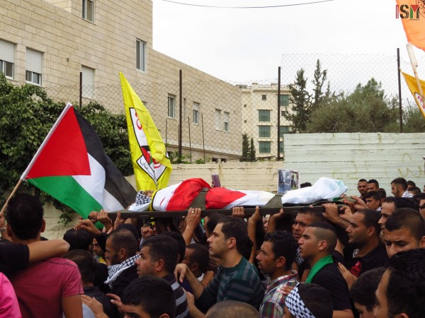 The body of Abed al-Rahman Obeidallah at the funeral march
