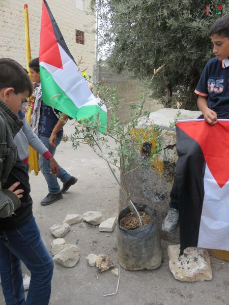 Abed al-Rahman Obeidallahs classmates mourning at the place where Israeli forces shot him