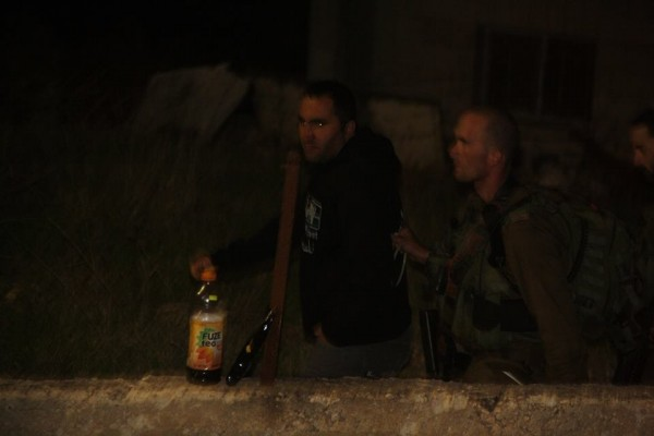Israeli forces arresting Issa Amro