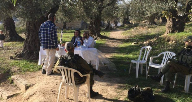 Illegal settlers close to the Soumud house