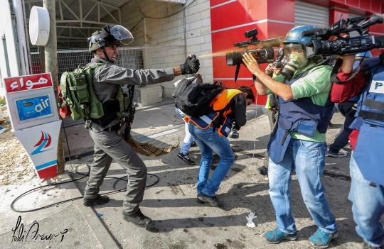 Israeli forces attacking journalists and medics (Ahmad) at clashes in Beit El Nov 30 - Photo credit Fadi Arouri