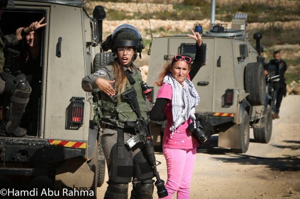 American woman peacefully participating in the demonstration arrested