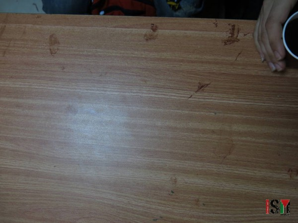 This desk shows blood stains of an injured student who needed urgent first aid treatment on site, while the hospitals was too crowded to receive more injured students.