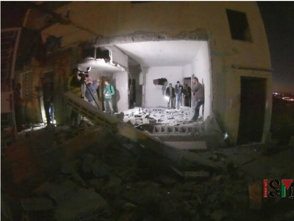 Lower floor of Samir Zahir Kusa's home reduced into rubble and broken walls